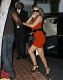 Mariah Carey in short red dress shows her legs and cleavage at Fred Segal store in Hollywood