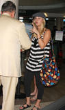 http://img209.imagevenue.com/loc573/th_05692_Kaley__Cuoco_at_LAX_HOPE_644_122_573lo.jpg