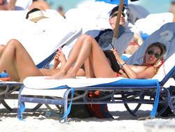 http://img209.imagevenue.com/loc587/th_260210827_lauren_stoner_bikini_topless_march19_2012_38_123_587lo.jpg